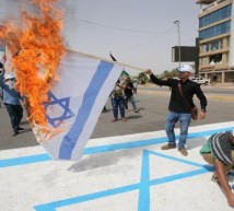 عراقيون يحرقون العلم الإسرائيلي